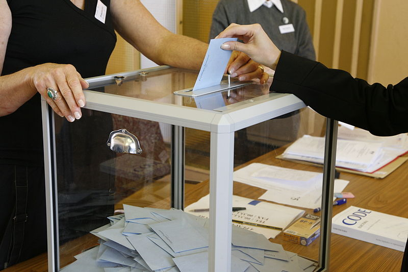 voting at a ballot box
